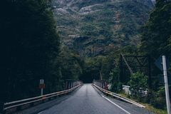 Road and tunnel through mountain royalty free stock photography