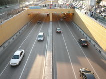 Road tunnel under bridge Stock Image