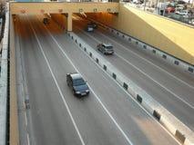 Road tunnel under bridge Stock Images