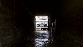 A road tunnel under a house stock footage