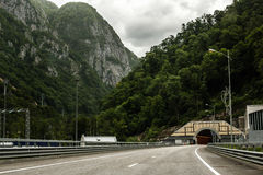 Road tunnel and wooded hills in Sochi Stock Photos