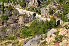 Road and tunnels. Road going through tunnels in mountainous area Stock Images