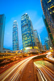 Road tunnels light trails on modern city buildings backgrounds i Royalty Free Stock Photography
