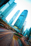 Road tunnels light trails on modern city buildings backgrounds i Royalty Free Stock Images
