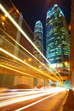 Road tunnels light trails on modern city buildings backgrounds i Royalty Free Stock Photo