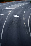 Road with turn direction lane marks Royalty Free Stock Photography