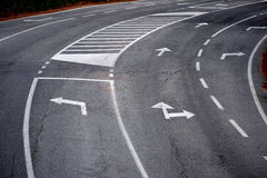 Road with turn direction lane marks Stock Photography