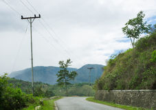 Road turn and green hills around Stock Photos