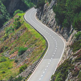 Road Turn in Mountains Stock Photo