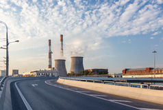 Road turn with power station Stock Photography