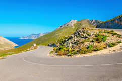 Road turn with sea coast on Greek island Royalty Free Stock Photography