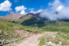 Road turn in Tien Shan mountains Royalty Free Stock Photos