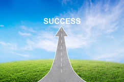 Road turning into an arrow rising upward with a road sign of success, symbolizing the direction to success. Stock Image