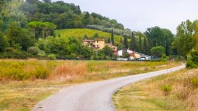 Road through a Tuscan Village stock image