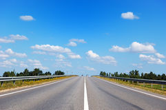 Road with two cars going in the opposite direction Royalty Free Stock Photos