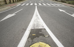 Road with two lanes. And directional arrows, road traffic and traffic regulations Royalty Free Stock Photos