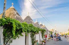 A road among typical trulli buildings in Alberobello, Apulia, It Stock Images
