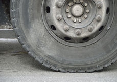 Road tyre. A tyre of a truck in the road Royalty Free Stock Photos