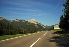Road in the Tyrolean Alps. In the direction of the mountain Red Flüh Royalty Free Stock Photo