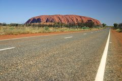 Road beside Uluru,. A world heritage landscape in outback Australia. Ayers Rock. Northern Territory, Australia Royalty Free Stock Photo