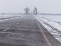 Road under the blizzard. Snowstorm Royalty Free Stock Images