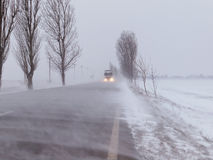 Road under the blizzard. Snowstorm stock photo
