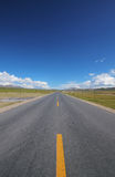 A road under the blue sky Stock Photography