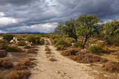 Road under clouds. It was sooting near small village Loufou in the mountings of Cyprus clous to the sunset Stock Photo