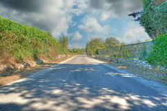 Road under clouds Royalty Free Stock Images