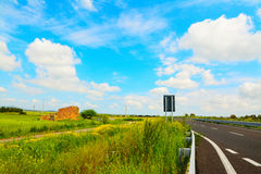 Road under a cloudy sky Royalty Free Stock Images