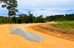 Road under construction. Stones for road construction with beautiful curve Royalty Free Stock Image