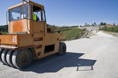 Road under construction. With heavy duty machinery Royalty Free Stock Photos