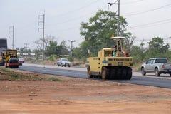 Road under construction, pneumatic tyred roller paver at asphalt Stock Images