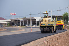 Road under construction, pneumatic tyred roller paver at asphalt Royalty Free Stock Images