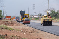 Road under construction, pneumatic tyred roller paver at asphalt Stock Photos