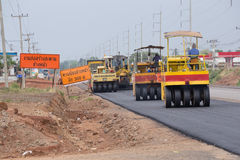 Road under construction, pneumatic tyred roller paver at asphalt Royalty Free Stock Photos
