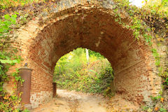 Road under historical arch from red bricks in Kachanivka park. Sandy road under historical arch from red bricks in Kachanivka park Stock Images