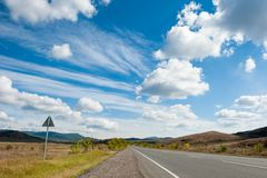 Road under the sky with clouds Royalty Free Stock Photo
