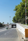 Road under a tunnel. Road with raised barrier under a tunnel in Barcelona, Catalonia, Spain Royalty Free Stock Image