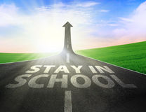 Road with up arrow sign and stay in school text Royalty Free Stock Images