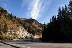 The Road Up Big Cottonwood Canyon. Paved two lane road going up Big Cottonwood Canyon in Utah in  the autumn Stock Photo