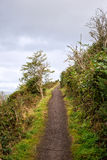 Road uphill, Holyrood park, Edinburgh. Scotland stock photo