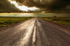 Road vainishing into the sunset Stock Image