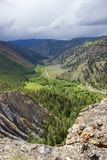 Road through valley in Cariboo-Chilcotin region of British Columbia. View of a mountain road through a valley in the central British Columbia, Canada, region Stock Images