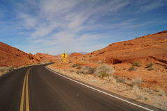 Road in Valley of Fire with road sign. Nevada Royalty Free Stock Images
