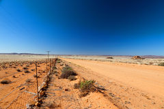 Road through a vast, arid landscape Royalty Free Stock Photography