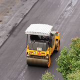 Road vehicle for compacting asphalt. Royalty Free Stock Photos