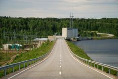 Road via Vanttauskoski hydroelectric plant Royalty Free Stock Photo