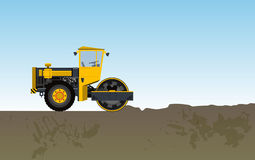 Road vibratory roller is rolled clay. Yellow roadroller builds roads. Stock Images