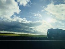 Road view with road, asphalt, clouds, and truck in France Europe royalty free stock photo